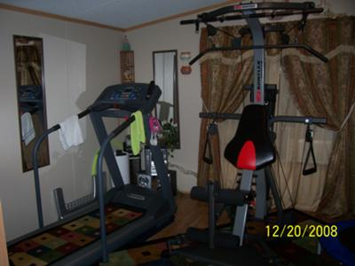 The treadmill next to my Bowflex